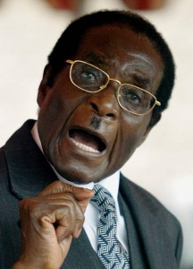 Zimbawe President Robert Mugabe goes with these always understated Hitler moustache